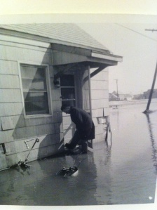 Arthur Leib rescuing the blue Bethany Beach house in the 1962 flood