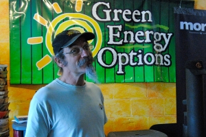 Pablo Fleischmann flashes a grin at his solar store in Keene, NH