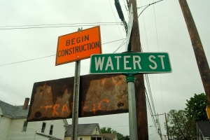Some construction to repair a road and infrastructure on the flood-prone Water St. in Keene