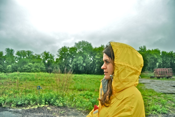 The author, Allie Goldstein, at Intervale Community Farms on a rainy day in Vermont. (Photo by the other author, Kirsten Howard.)