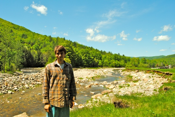 Ryan Wood Beauchamp stands by the river that now runs through his farm.