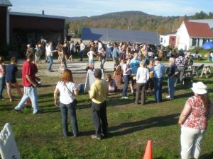 Neighbors danced and sang at a 'support raising' event at Evening Song Farm (photo from their Facebook page).