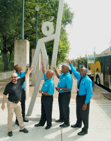Douglas Kornfeld does the EvacuSpot pose with New Orleans Regional Transit Authority bus drivers
