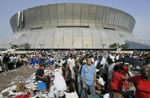 Thousands of survivors surround the Superdome waiting to be evacuated. REUTERS/Jason Reed