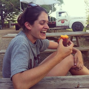 Allie eats a peach grown in Paonia, Colorado's special climate