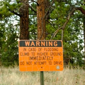 Signs warn of flood risk near the Hayman burn scar.