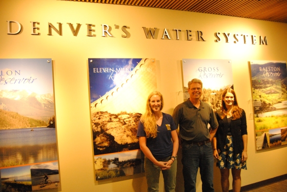 Kirsten Howard (left) and Allie Goldstein (right) stand with Don Kennedy at Denver Water's headquarters.