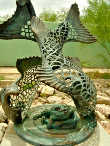This statue by Tucson artist Joseph Lupiani depicts a horn lizard within a Sonora suckerfish.