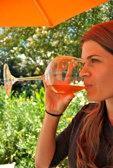 Allie Goldstein enjoys a glass at Saintsbury winery and vineyard.