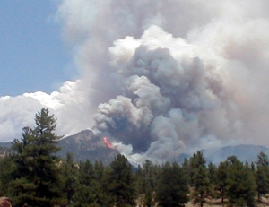 The 2002 Hayman Fire burning in the distance. Source: Teller County
