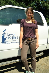 Road tripper Allie Goldstein poses next to a Taylor Shellfish truck