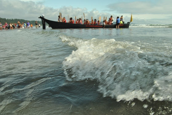 A tribe is welcomed ashore by the Quinault Nation after the two week canoe paddle.