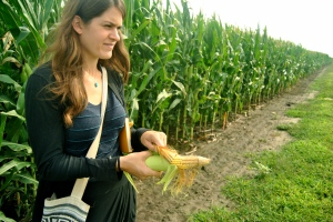 Allie shucking some corn.