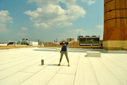 Road tripper Kirsten Howard embraces a sunny day on the roof