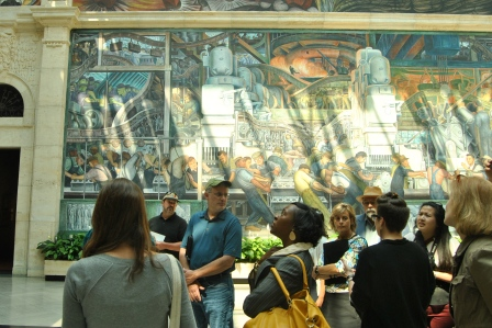 Kimberly Hill Knott (looking up), the convener of the DCAC, with colleagues in the Diego Rivera room at the Detroit Institute of Art
