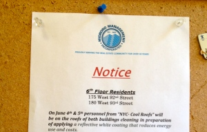 A notice in a New York City building informs residents of their soon-to-be cool roof